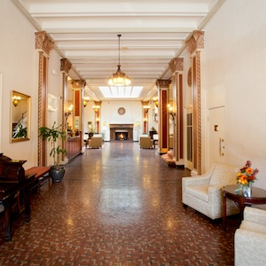 Inside the main entrance of the hotel leading to the lobby and front desk