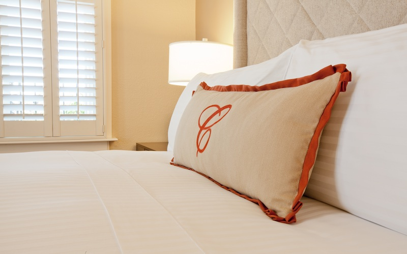 Cardinal Hotel custom made pillow with the big letter C of the logo monogrammed