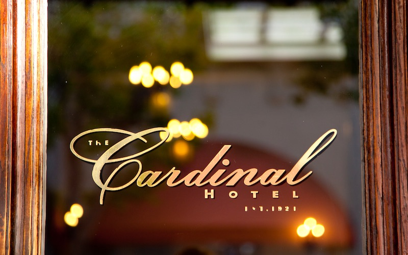 Cardinal Hotel entrance door with logo on the window