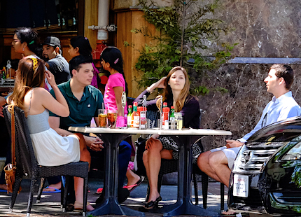 Group of people having drinks at a restaurant outside table
