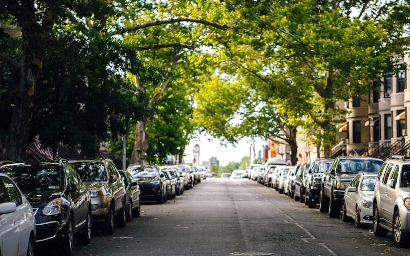 Street with cars parked on both sides