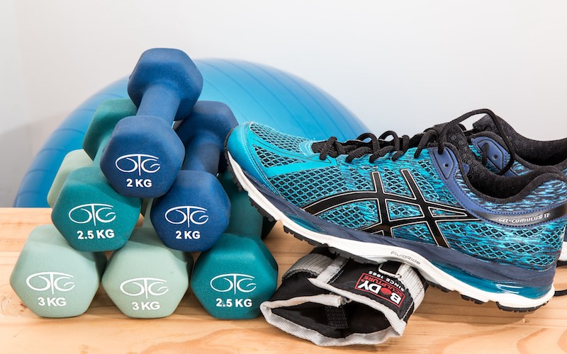 weights and a running shoe on a table