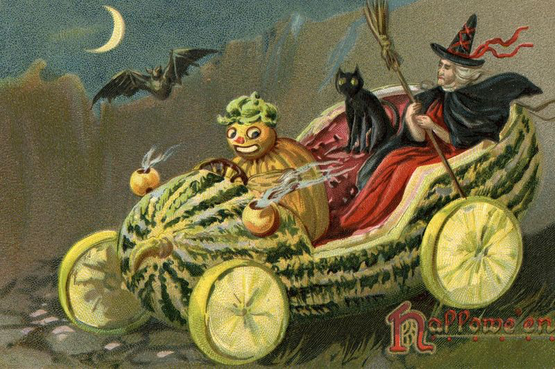 postcard image of an anamorphic pimpkin, at and witch sitting in a pumpkin shaped like a car