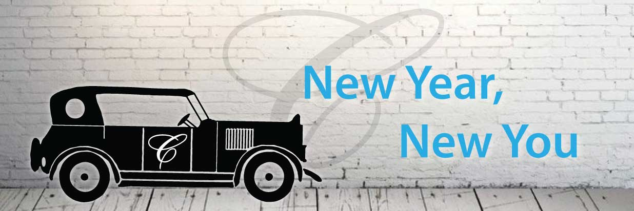 Text: New Year, New You with a vintage cardinal hotel car logo and a white brick wall background