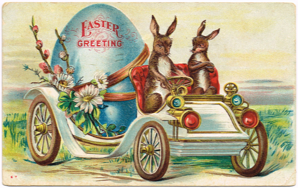 vintage easter themed car carrying a giant egg being driven by rabbits